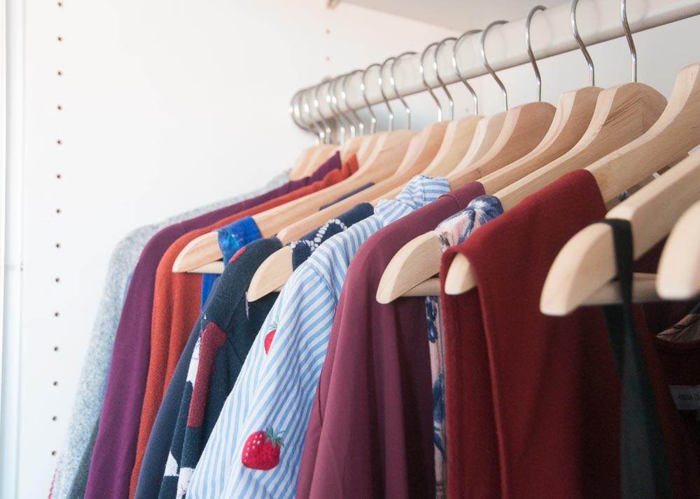 Pictured: Clothes hanging in a closet after a Closet Audit.